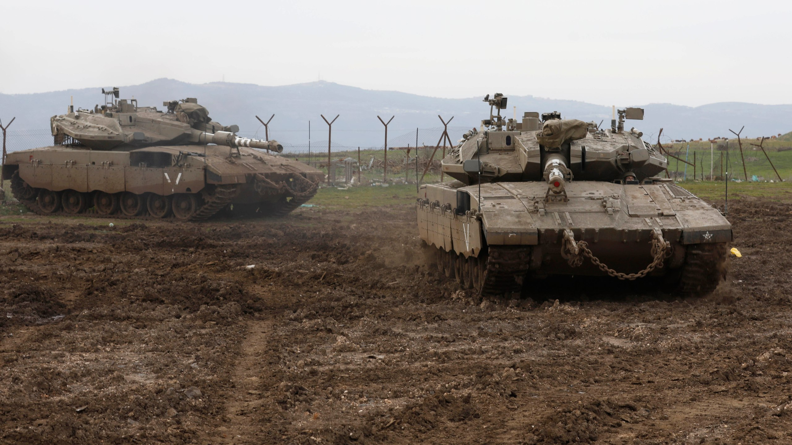 Israeli army Merkava tanks gather in the Israeli-annexed Golan Heights, on January 20, 2019. - Israel's military said its air defence systems intercepted a rocket fired from Syria today, after Damascus accused Israel of carrying out air raids. 'A short while ago, a rocket was fired at the northern Golan Heights and was intercepted by the 'Iron Dome' aerial defence system,' an Israeli military statement said. (Credit: Jalaa Marey/AFP/Getty Images)