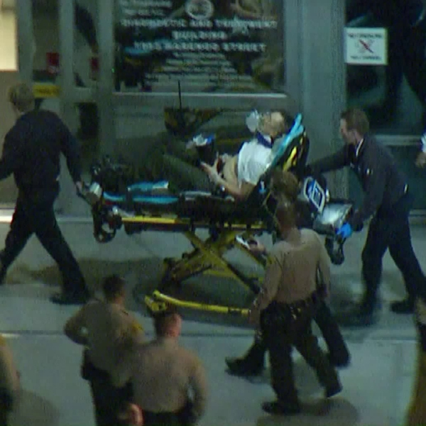 A deputy is wheeled into the LAC+USC Medical Center in Boyle Heights after being injured in Temple City on Jan. 29, 2019. (Credit: KTLA)