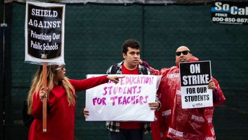 Gloria Perez-Stewart stands on the picket line with her son, Aidan Villasenor Walker, and husband John Stewart on Jan.15, 2019. Aidan, who has autism, is a student at Eagle Rock Jr./Sr. High School. (Credit: Kent Nishimura / Los Angeles Times)