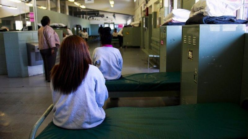 An undated photo shows girls detained at Camp Kenyon Scudder sitting in their shared dorm space at the Santa Clarita juvenile probation facility. (Credit: Los Angeles Times)
