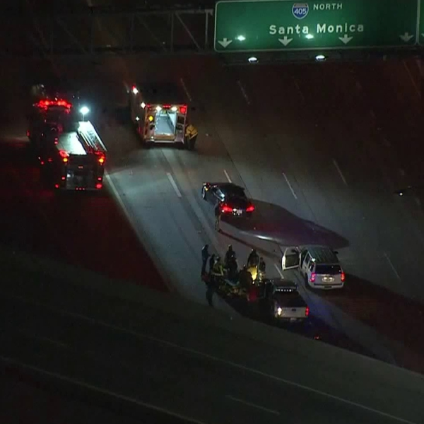 The scene of a crash involving a motorcycle officer in an area of the 405 Freeway where it meets the 605 is seen in this footage from the morning of Feb. 21, 2019. (Credit: KTLA)