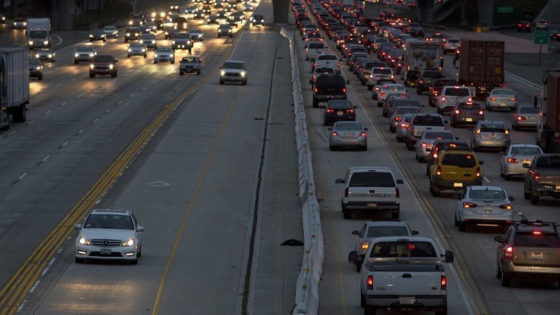Motorists travel on the 405 Freeway through Costa Mesa, where demolition and reconstruction of the Fairview Road bridge over the freeway is planned. (Credit: Los Angeles Times)