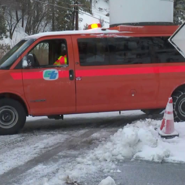 A Caltrans van is seen at a blocked portion of Green Valley Lake Road in the Big Bear area on Feb. 16, 2019. (Credit: KTLA)