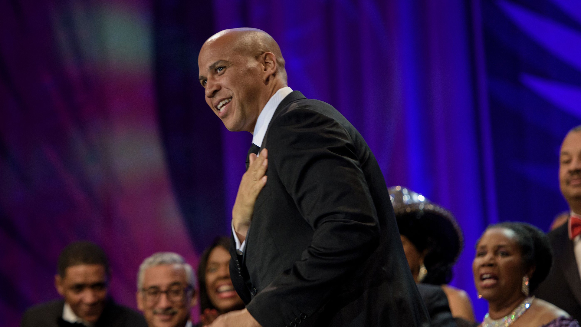 Rep. Cory Booker (D-NJ) arrives while being introduced with other African American members of the US Congress during the Congressional Black Caucus Foundation's Phoenix Awards Dinner Sept. 17, 2016, in Washington, D.C.(Credit: BRENDAN SMIALOWSKI/AFP/Getty Images)