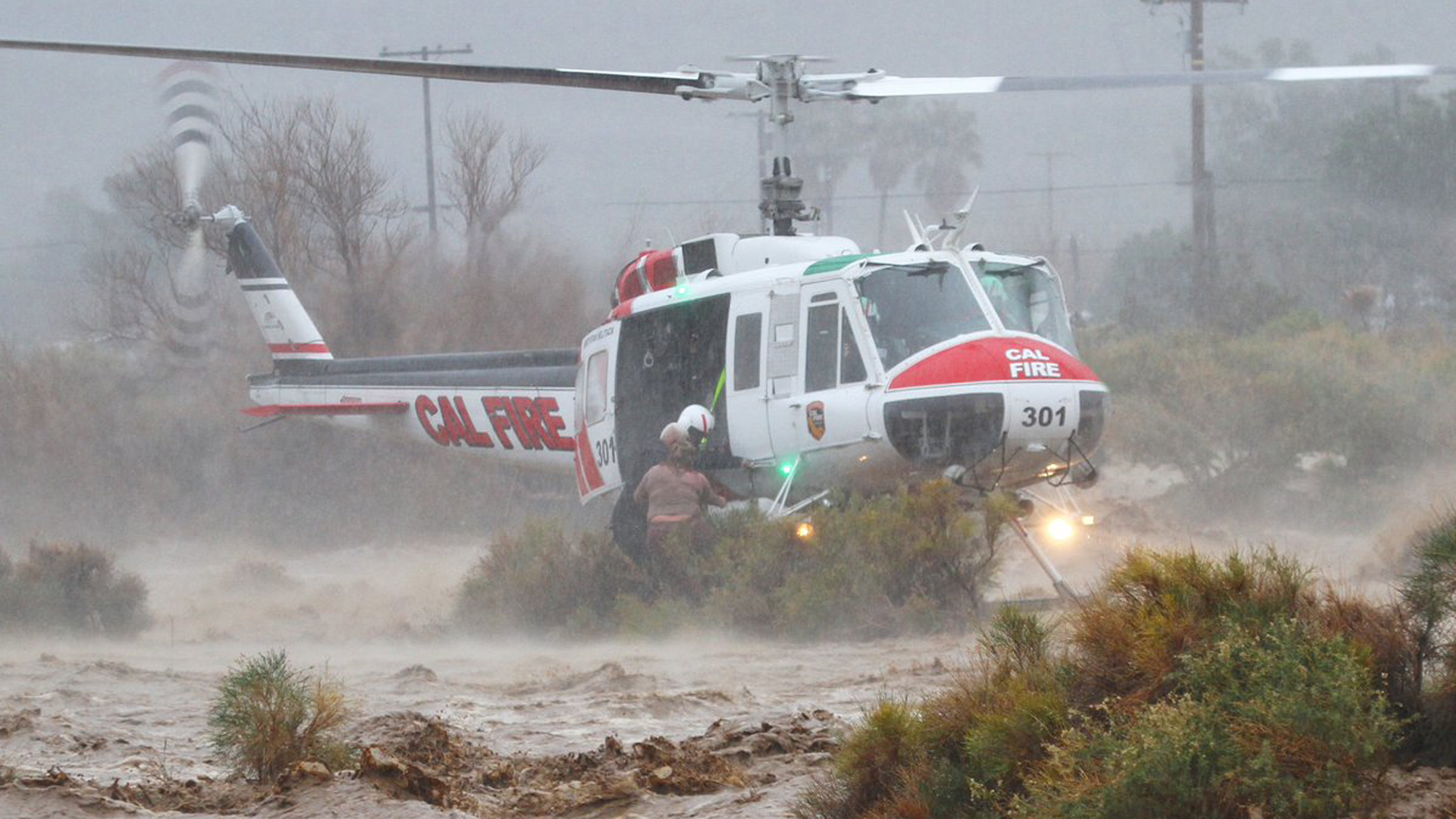 A Cal Fire helicopter works to rescue to people from flooding in Cabazon on Feb. 14, 2019. It was one of dozens of rescues carried out that day.(Credit: Cal Fire Riverside)