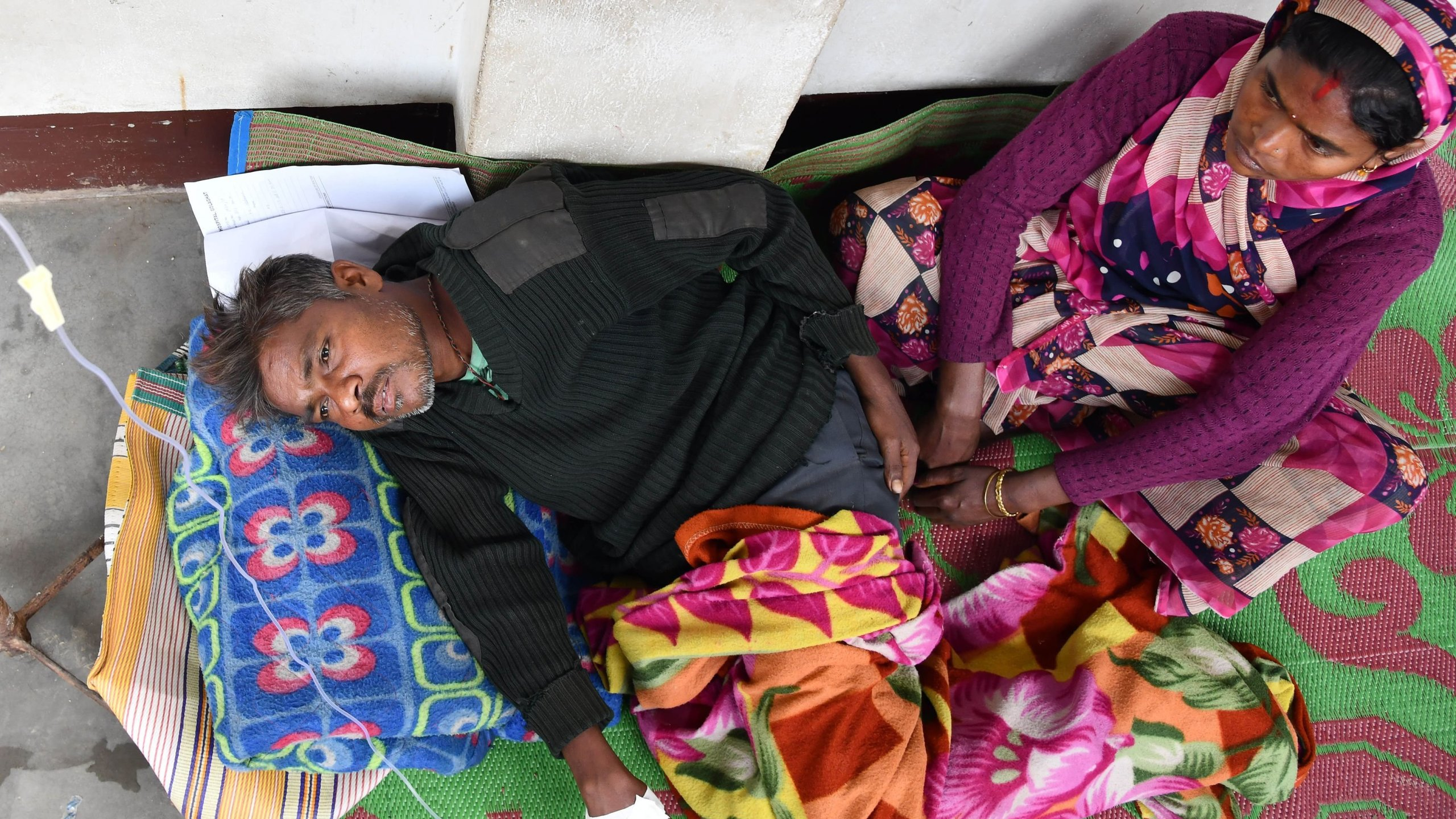 At least 133 people have died and more than 200 others have been hospitalized after consuming tainted alcohol in India, officials said. (Credit: CNN)