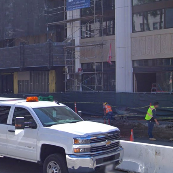 The Mansfield at Miracle Mile, a luxury apartment building, seen under construction in March 2018, is one of 35 projects across L.A. where more than 1,000 construction workers were cheated out of their wages, the California labor commissioner says. (Credit: Google Maps)