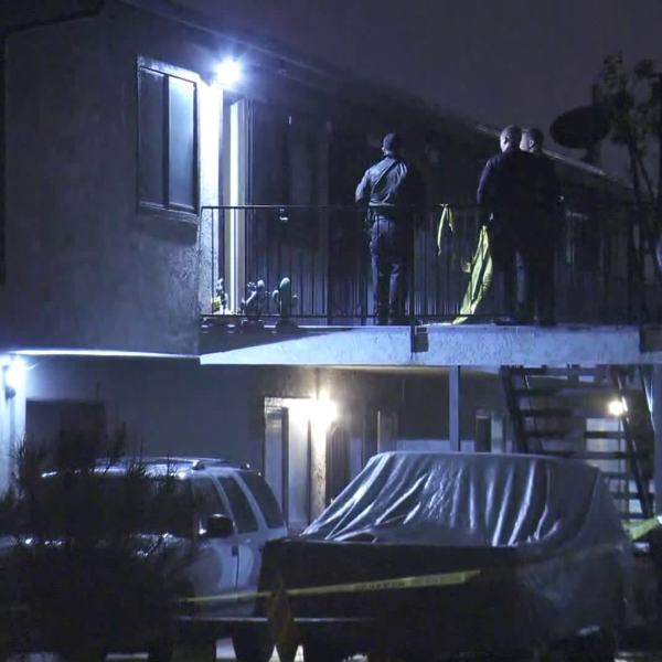 Authorities investigate after two people were found dead inside a Covina residence on Feb. 13, 2019. (Credit: KTLA)
