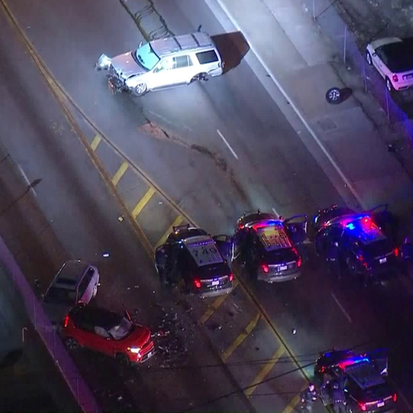 At least three passenger vehicles were damaged after being hit by an SUV driver fleeing authorities in Huntington Park on Feb. 5, 2019. (Credit: KTLA)