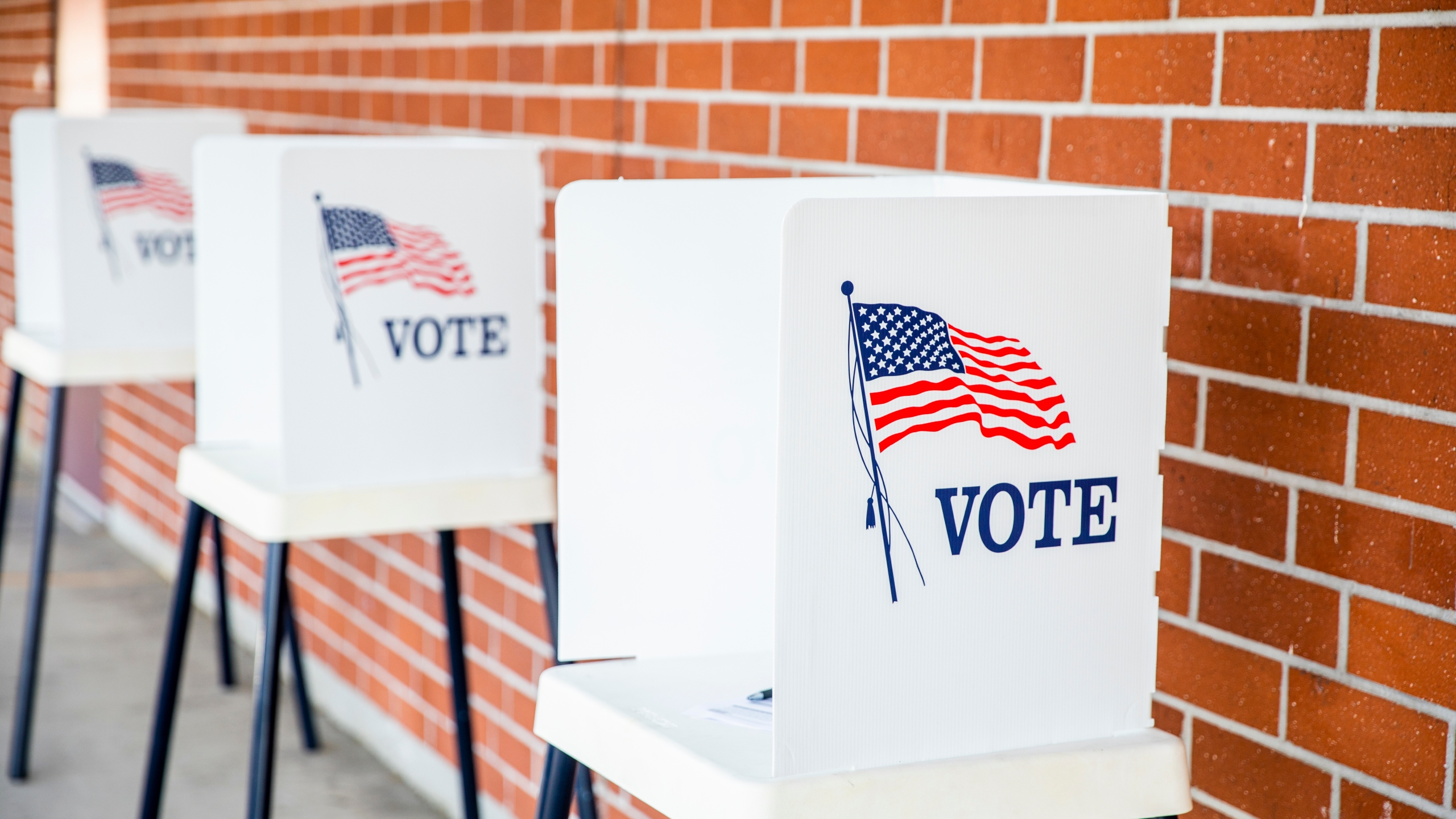 A polling location station is seen in a file photo. (Credit: iStock / Getty Images Plus)