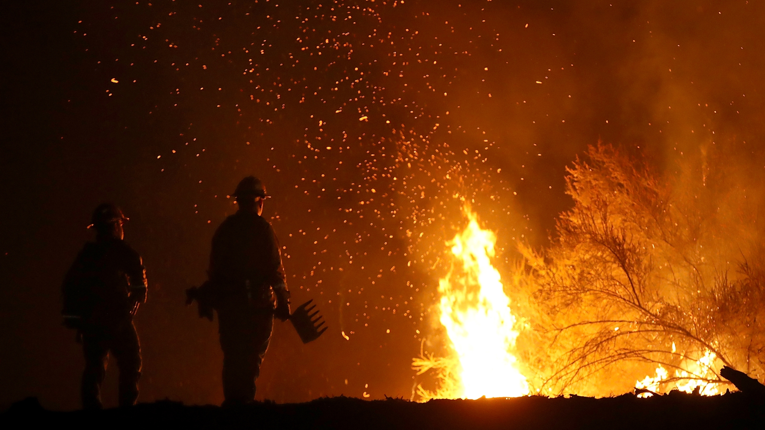 Cal Fire firefighters monitor a back fire as they battle the Medocino Complex Fire on Aug. 7, 2018, near Lodoga. (Credit: Justin Sullivan/Getty Images)