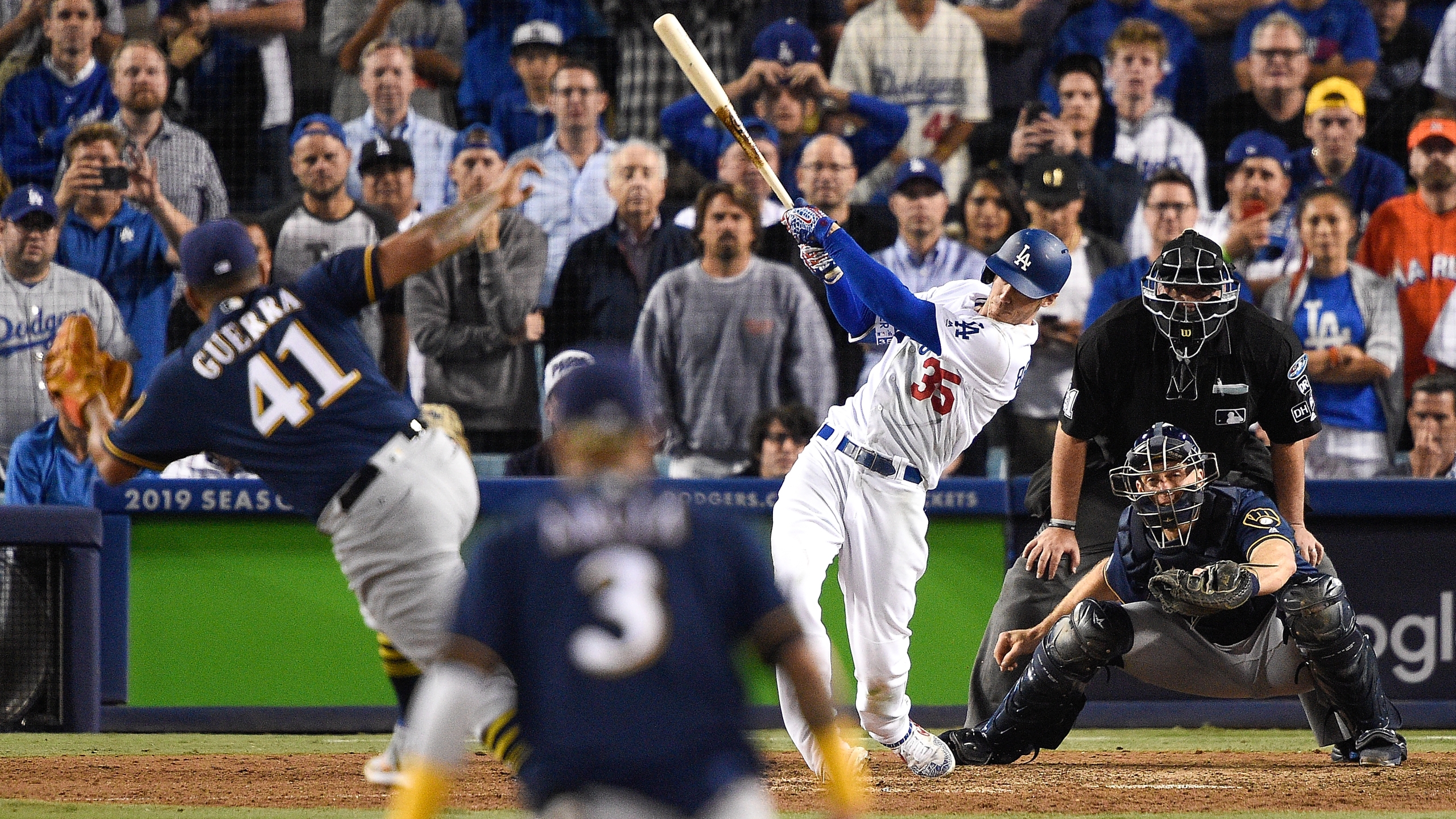 Cody Bellinger of the Los Angeles Dodgers hits a walk-off single in the thirteenth inning against the Milwaukee Brewers to win Game Four of the National League Championship Series Dodger Stadium on Oct. 16, 2018. (Credit: Kevork Djansezian/Getty Images)