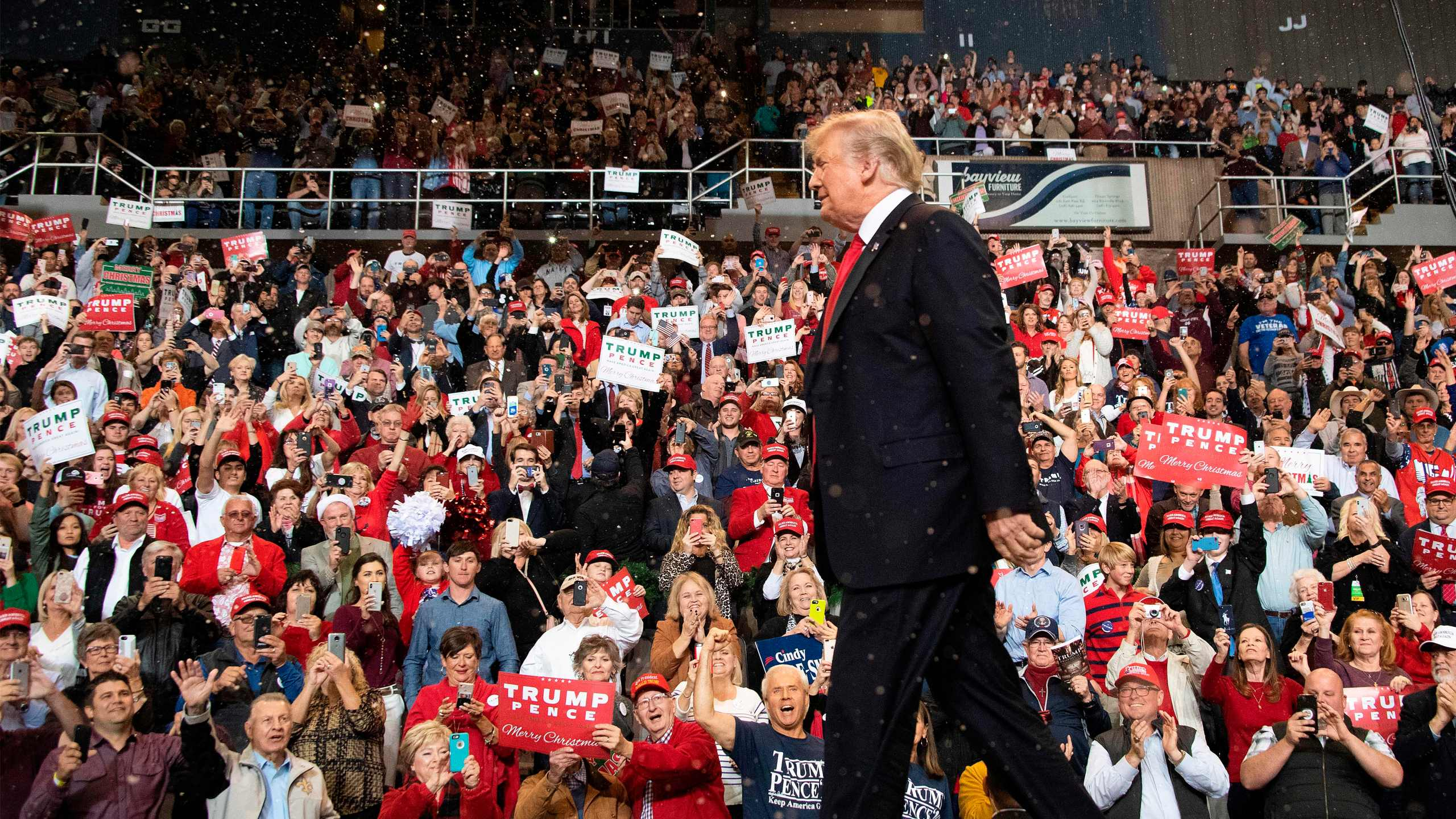 President Donald Trump walks on stage at a Make America Great Again rally in Biloxi, Mississippi, on November 26, 2018. (Credit: JIM WATSON/AFP/Getty Images)