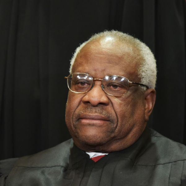 Associate Justice Clarence Thomas poses for the official group photo at the U.S. Supreme Court on November 30, 2018. (Credit: MANDEL NGAN/AFP/Getty Images)