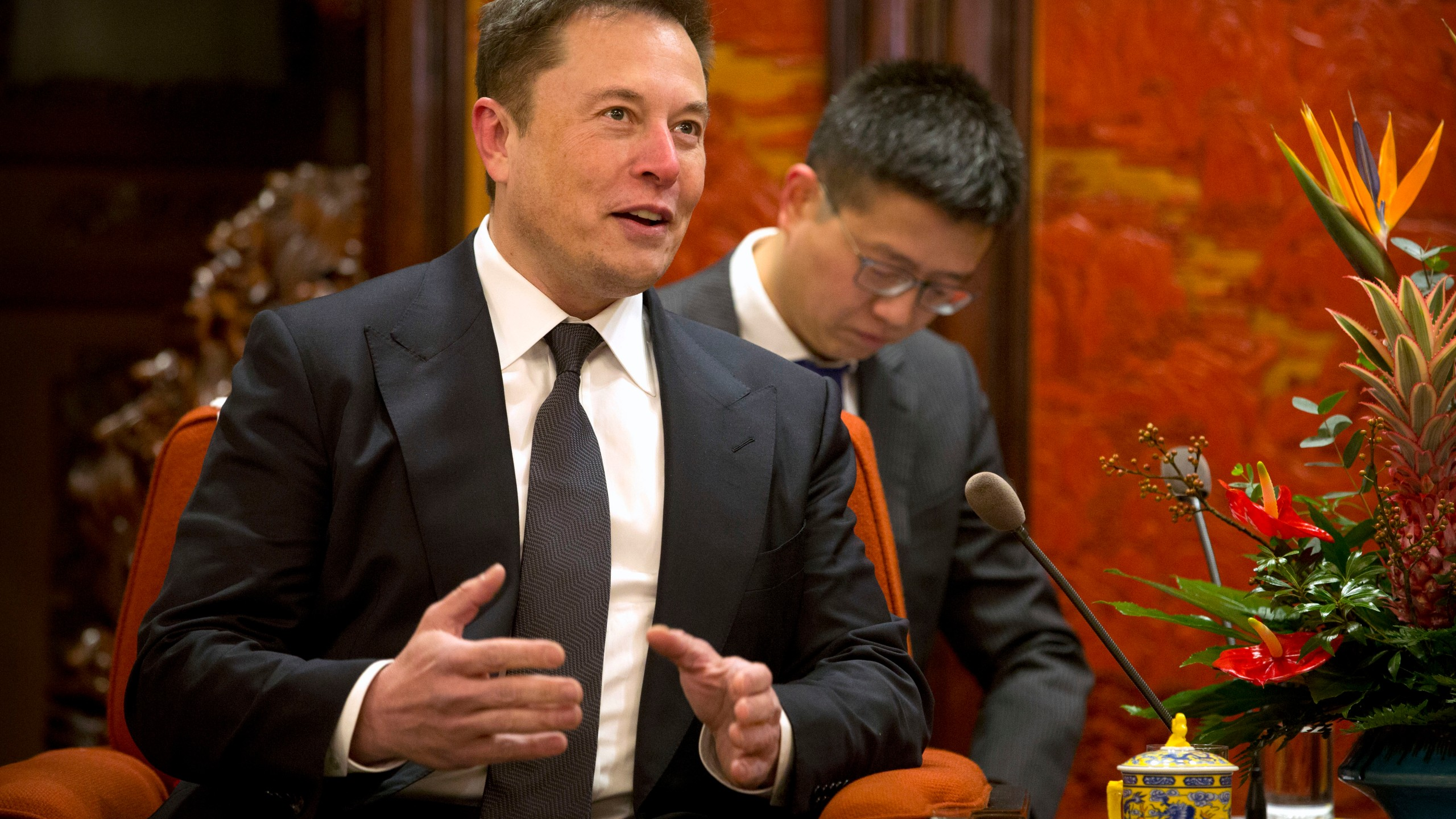 Tesla CEO Elon Musk speaks during a meeting with Chinese Premier Li Keqiang (not pictured) at the Zhongnanhai leadership compound in Beijing on Jan. 9, 2019. (Credit: Mark Schiefelbein / AFP / Getty Images)