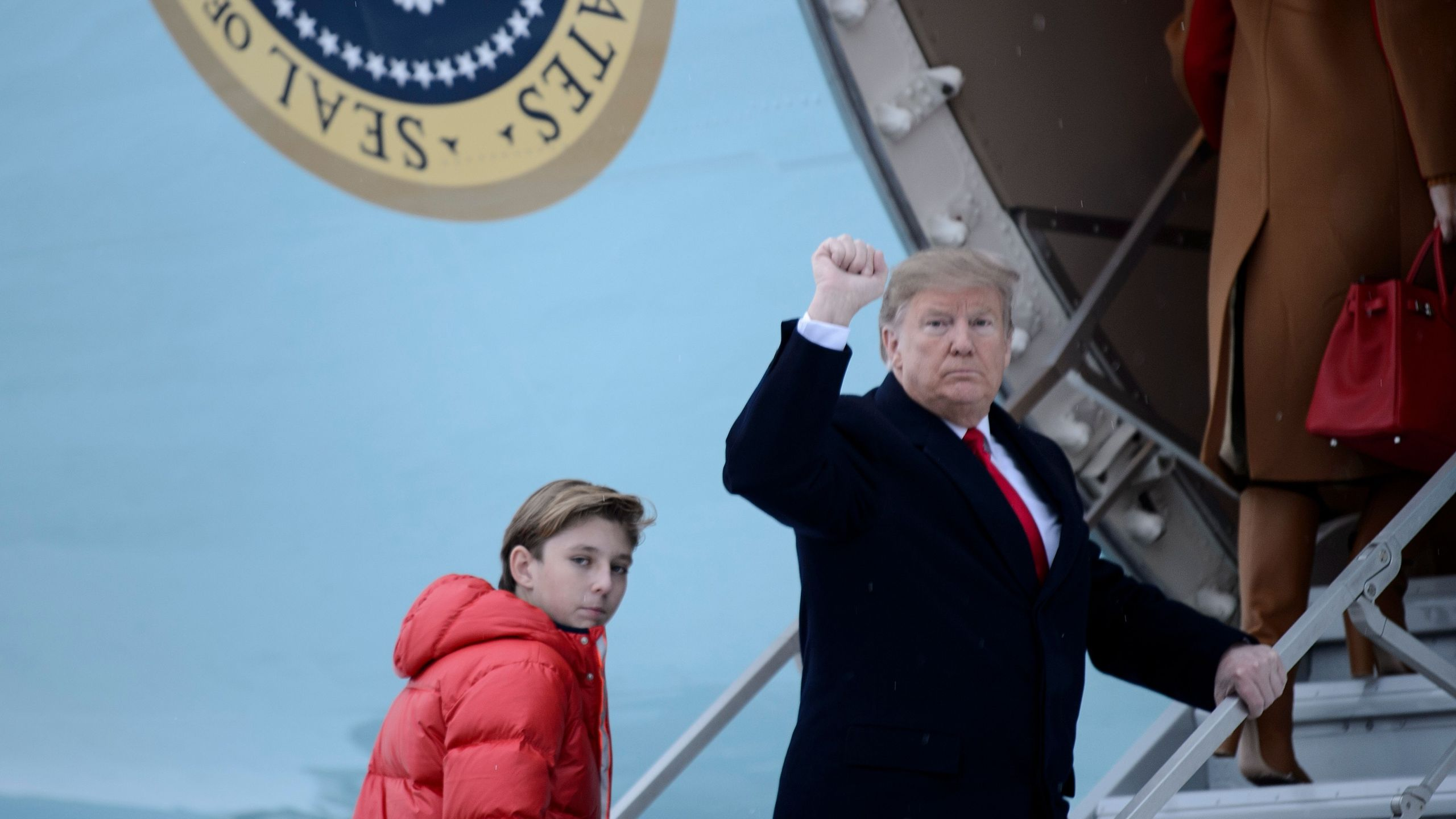 US President Donald Trump and son Barron Trump board Air Force One at Andrews Air Force Base on Feb. 1, 2019, in Maryland, en route to Palm Beach, Fla. (Credit: Brendan Smialowski/AFP/Getty Images)