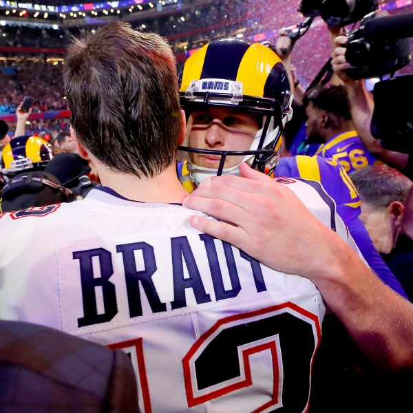 Tom Brady of the New England Patriots hugs Jared Goff of the Los Angeles Rams after the Patriots defeat the Rams 13-3 during Super Bowl LIII at Mercedes-Benz Stadium on Feb. 3, 2019 in Atlanta, Georgia. (Credit: Kevin C. Cox/Getty Images)