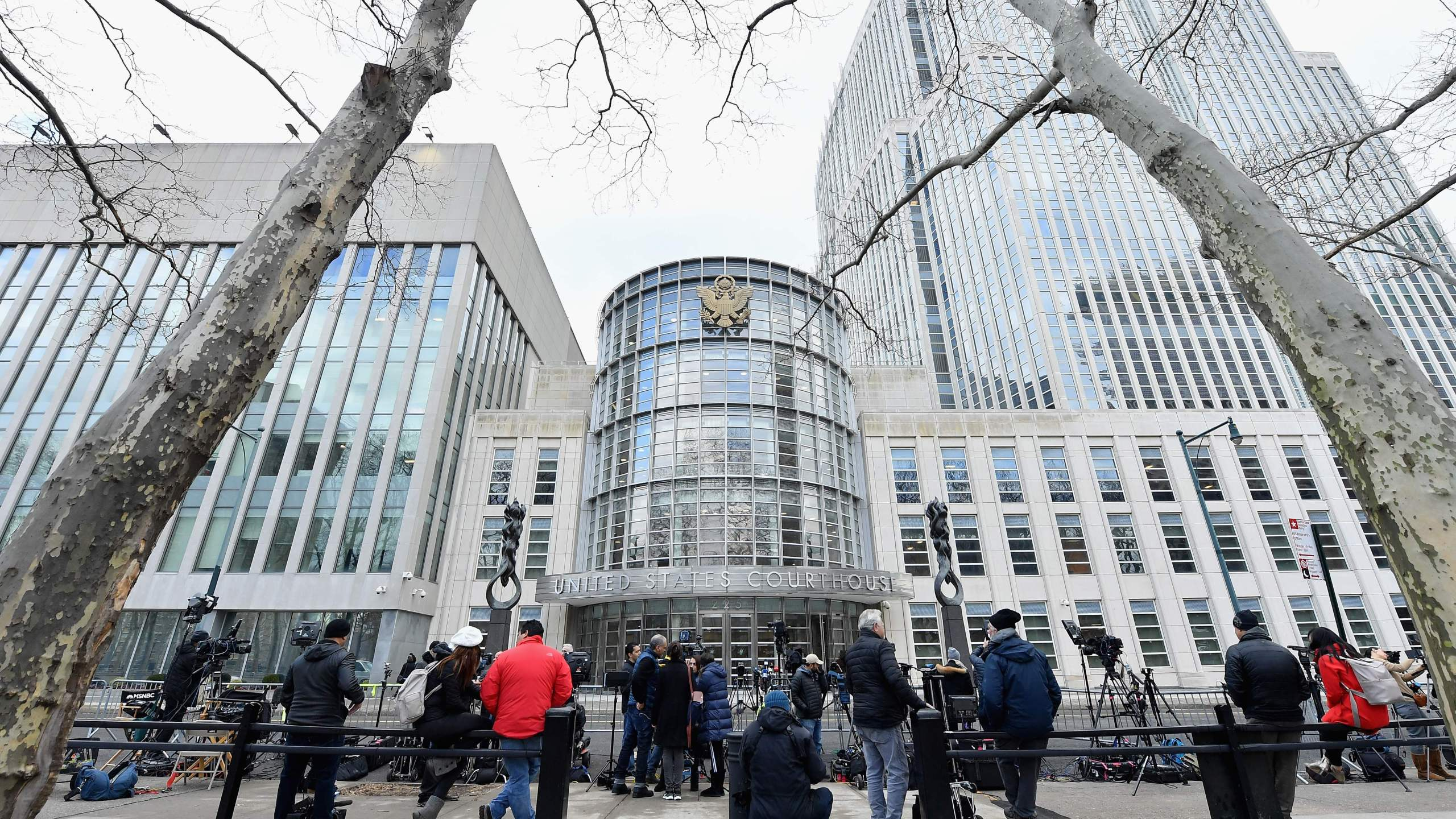 "Members of the media gather in front of the U.S. Federal Courthouse during the trial of Mexican drug lord Joaquin ""El Chapo"" Guzman on Feb. 5, 2019 in Brooklyn, New York. (Credit: ANGELA WEISS/AFP/Getty Images)"