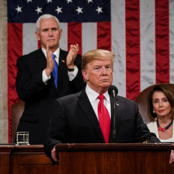 Donald Trump, with Speaker Nancy Pelosi and Vice President Mike Pence looking on, delivers the State of the Union address in the chamber of the U.S. House of Representatives at the U.S. Capitol Building on Feb. 5, 2019 in Washington, D.C. President Trump's second State of the Union address was postponed one week due to the partial government shutdown. (Credit: Doug Mills-Pool/Getty Images)