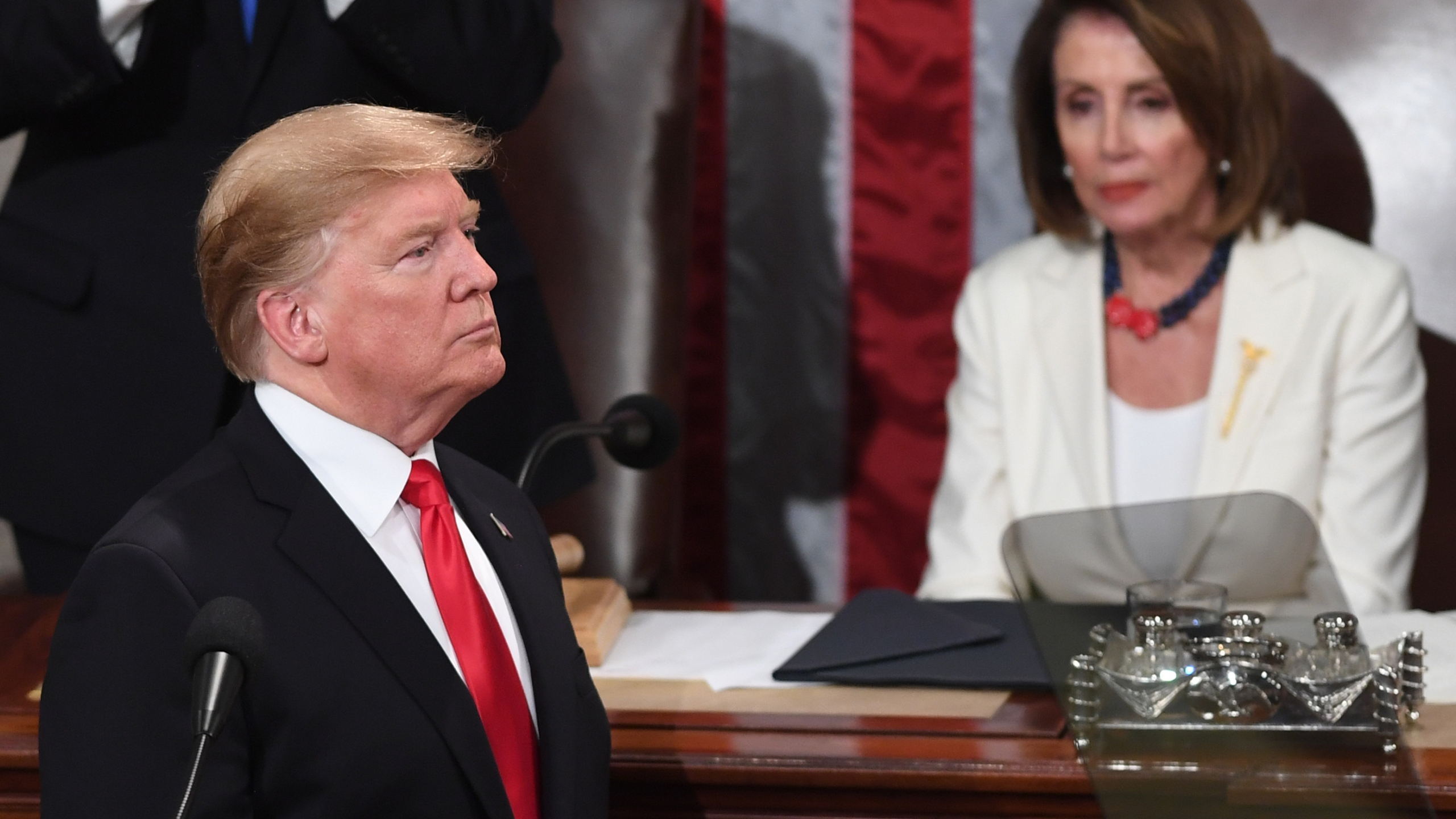 Donald Trump and Speaker of the U.S. House of Representatives Nancy Pelosi appear at the State of the Union address at the U.S. Capitol in Washington, D.C, on Feb. 5, 2019. (Credit: SAUL LOEB/AFP/Getty Images)