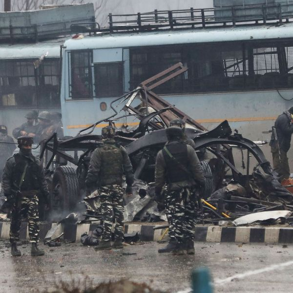 Indian security forces inspect the remains of a vehicle following a bomb explosion on a paramilitary Central Reserve Police Force convoy in Kashmir on Feb. 14, 2019. (Credit: STR/AFP/Getty Images)