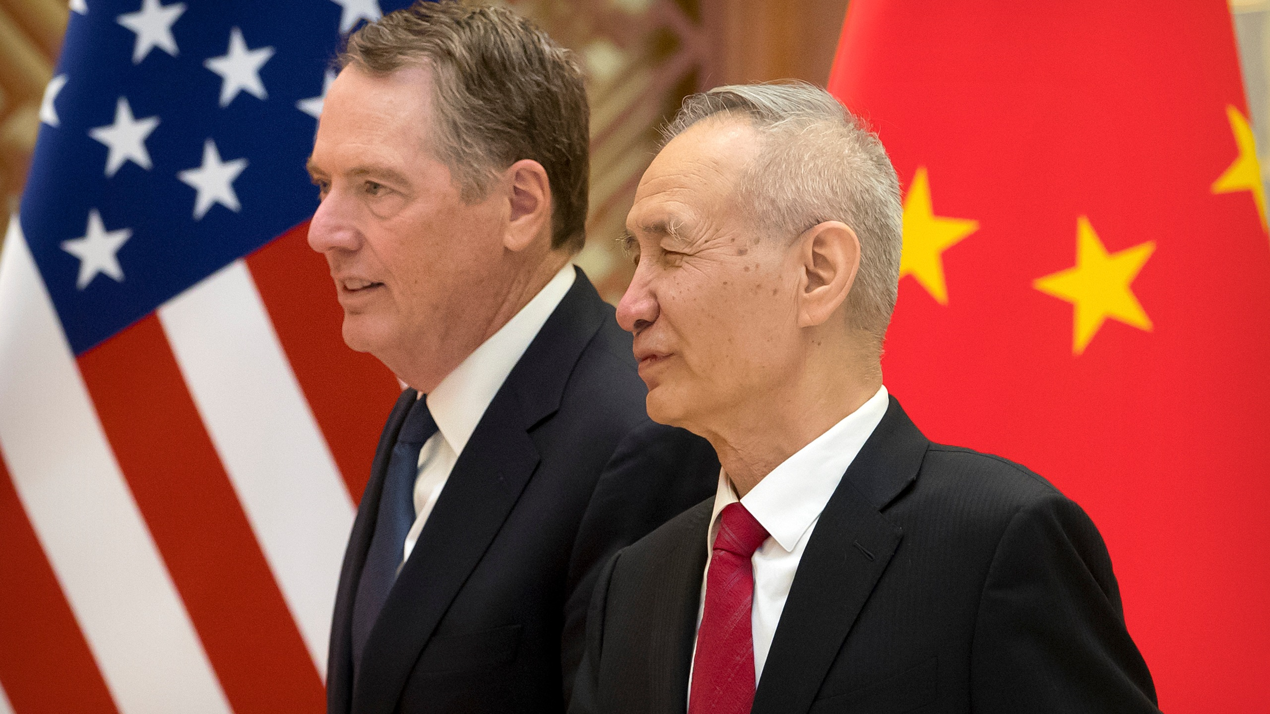 US Trade Representative Robert Lighthizer (L) listens as Chinese Vice Premier Liu He talks while they line up for a group photo at the Diaoyutai State Guesthouse in Beijing on February 15, 2019. (Credit: MARK SCHIEFELBEIN/AFP/Getty Images)
