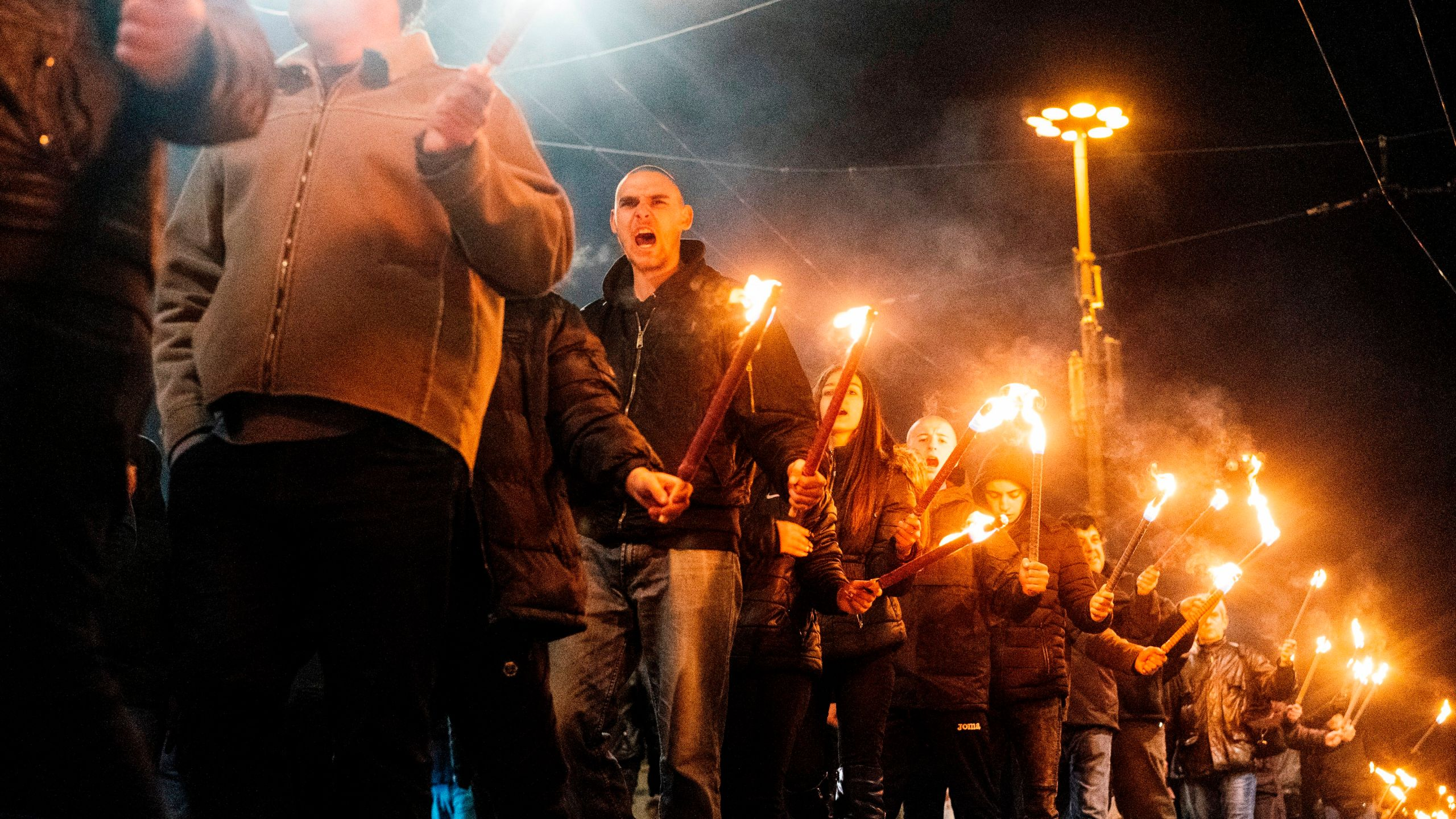 Members of nationalist organizations parade with torches during a march to commemorate Bulgarian General and politician Hristo Lukov, in the centre of Sofia on February 16, 2019. (Credit: DIMITAR DILKOFF/AFP/Getty Images)