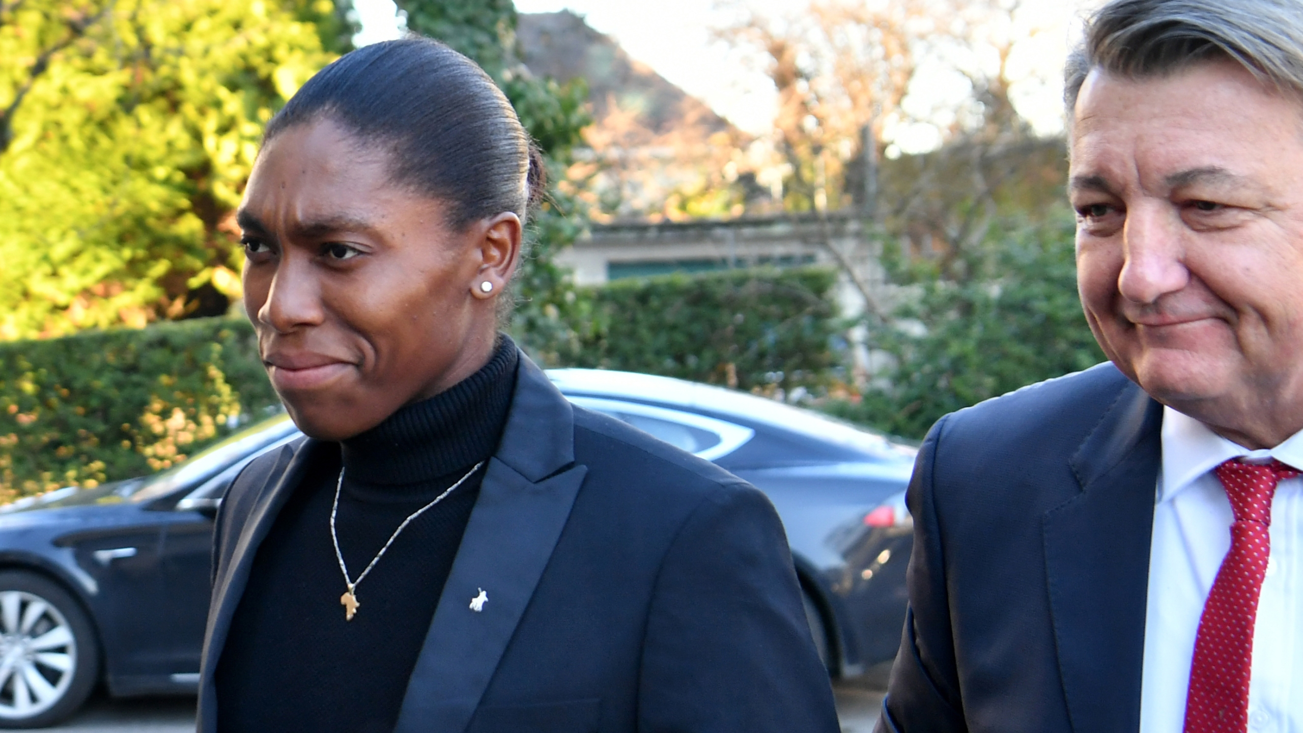 South African 800 meters Olympic champion Caster Semenya and her lawyer Gregory Nott arrive for a landmark hearing at the Court of Arbitration for Sport (CAS) in Lausanne on February 18, 2019. (Credit: HAROLD CUNNINGHAM/AFP/Getty Images)