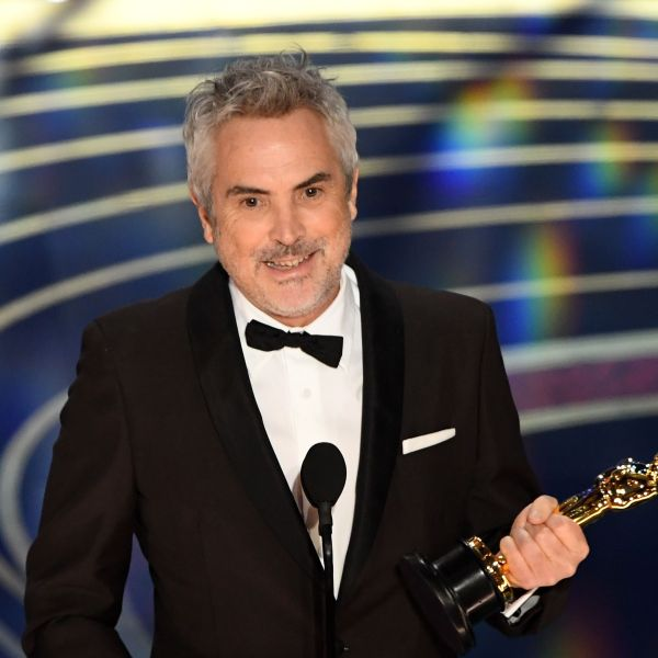 """Alfonso Cuaron accepts the award for Best Cinematography for """"Roma"""" during the 91st Annual Academy Awards at the Dolby Theatre in Hollywood on Feb. 24, 2019. (Credit: VALERIE MACON/AFP/Getty Images)"""