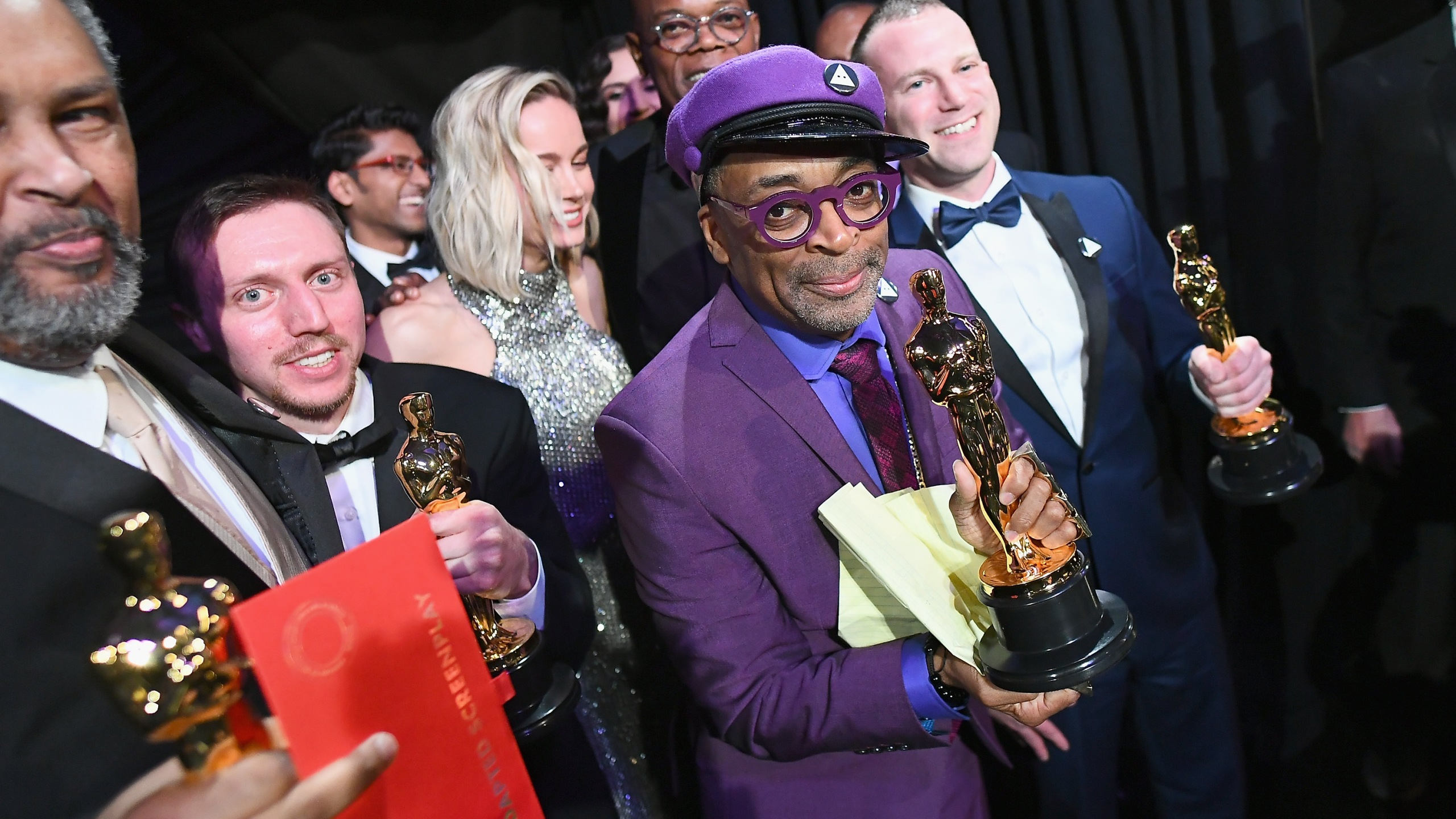 """In this handout provided by A.M.P.A.S., Spike Lee (second from right), pose with the Best Adapted Screenplay award for """"BlacKkKlansman"""" backstage during the 91st Annual Academy Awards at the Dolby Theatre on Feb. 24, 2019 in Hollywood. (Credit: Matt Petit - Handout/A.M.P.A.S. via Getty Images)"""