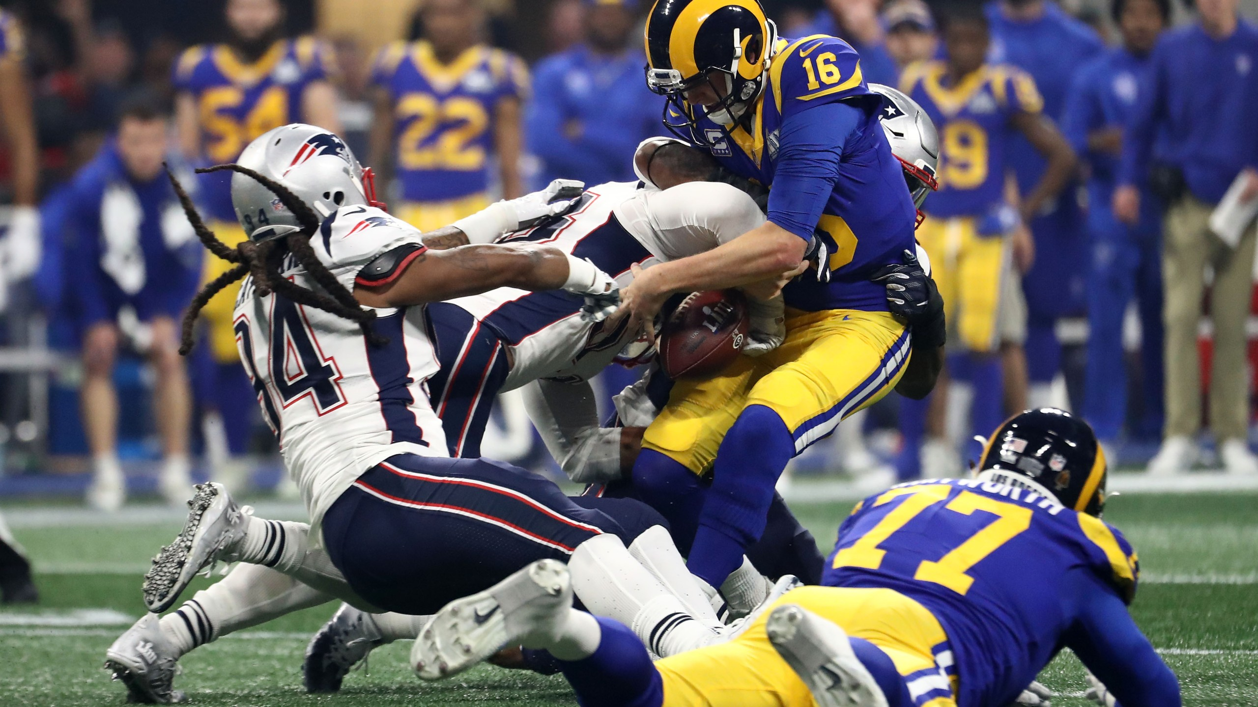 Jared Goff of the Los Angeles Rams, is sacked by Kyle Van Noy and Dont'a Hightower of the New England Patriots in the second half during Super Bowl LIII at Mercedes-Benz Stadium in Atlanta on Feb. 3, 2019. (Credit: Al Bello / Getty Images)