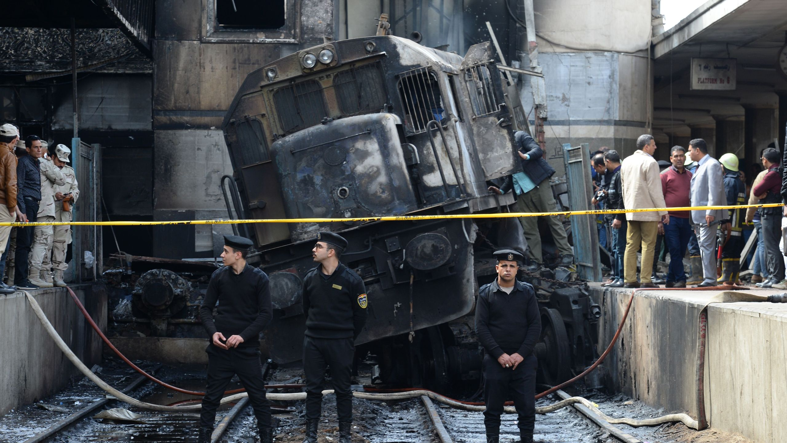 Members of the security forces and onlookers gather at the scene of a fiery train crash at the Egyptian capital Cairo's main railway station on Feb. 27, 2019. (Credit: MOHAMED EL-SHAHED/AFP/Getty Images)
