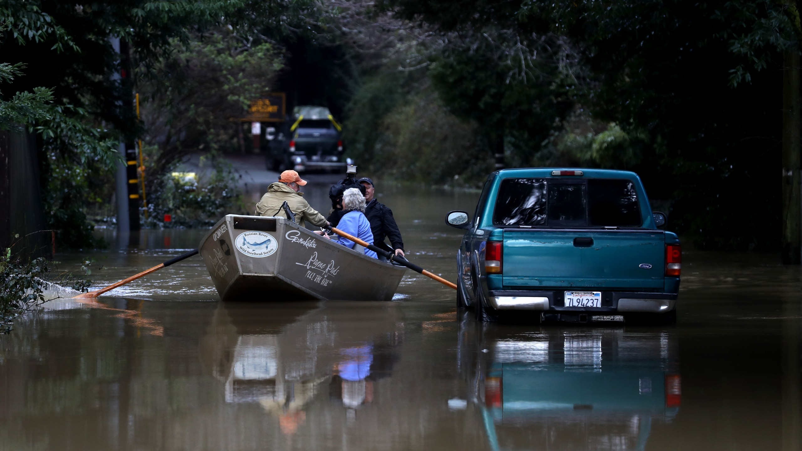 Residents use a boat to navigate floodwaters on Feb. 15, 2019 in Guerneville, Calif. An atmospheric river, a narrow corridor of concentrated moisture in the atmosphere, is bringing heavy rains to Northern California that is causing rivers to overflow their banks and flood many areas around the Russian River. (Credit: Justin Sullivan/Getty Images)