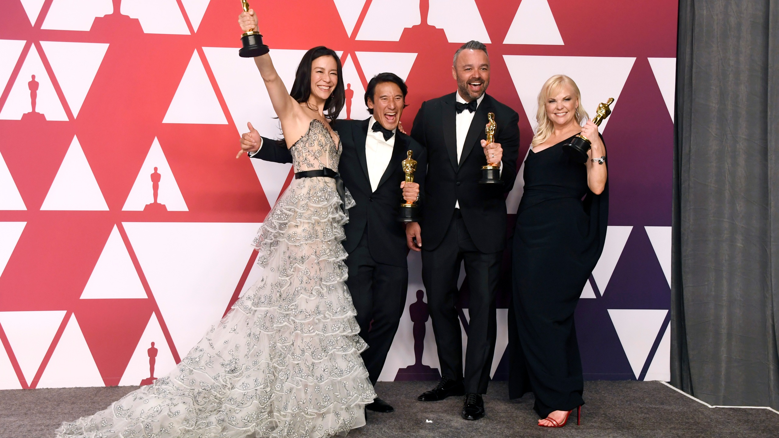 (L-R) Elizabeth Chai Vasarhelyi, Jimmy Chin, Evan Hayes, and Shannon Dill, winners of Best Documentary Feature for 'Free Solo,' pose in the press room during the 91st Annual Academy Awards at Hollywood and Highland on February 24, 2019 in Hollywood, California. (Credit: Frazer Harrison/Getty Images)