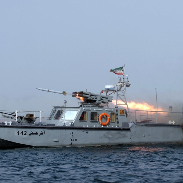 An Iranian war-boat fires a missile during navy exercises in the Strait of Hormuz in southern Iran on Dec. 30, 2011. (Credit: Ali Mohammadi/AFP/Getty Images)