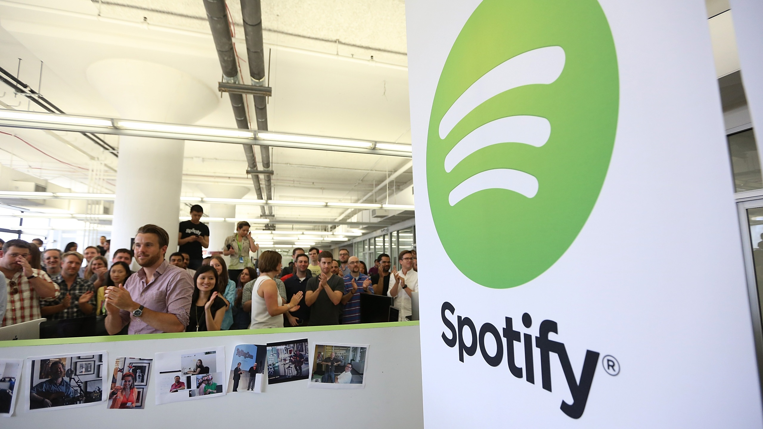 People gather in Spotify offices following a press conference on June 27, 2013 in New York City. (Credit: Mario Tama/Getty Images)