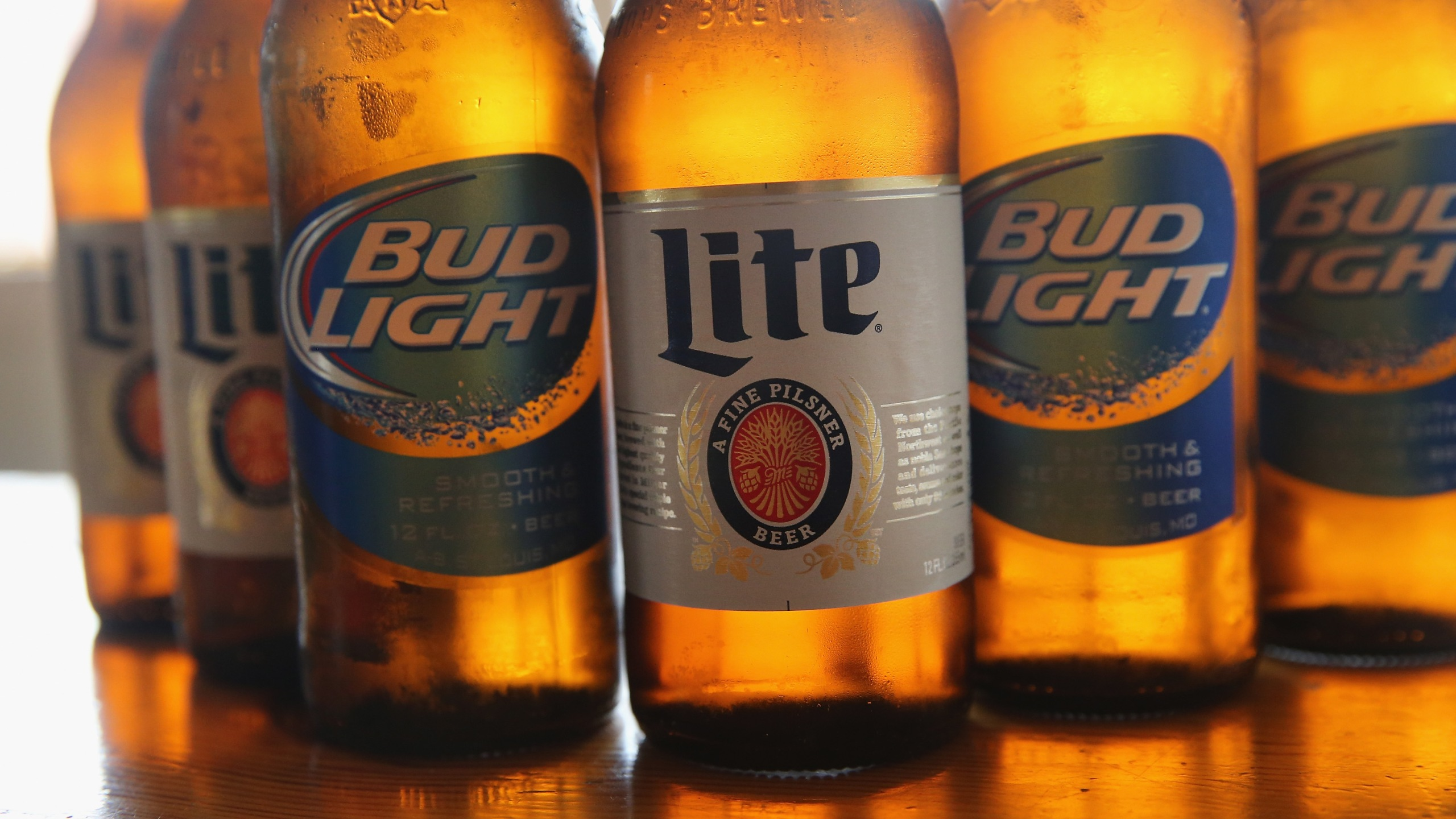 Bud Light and Miller Lite beers are seen in this photo. (Credit: Scott Olson/Getty Images)