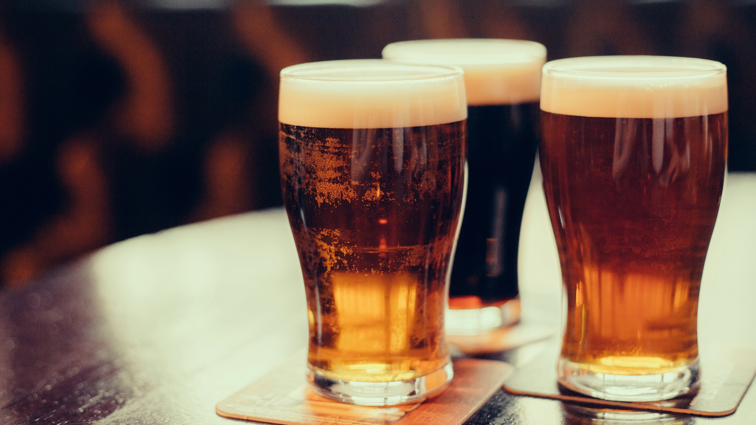 Glasses of beer are seen in a file photo. (Credit: iStock / Getty Images Plus)