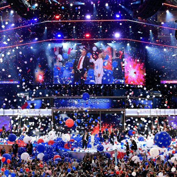 Balloons come down on Democratic presidential nominee Hillary Clinton and running mate Tim Kaine at the end of the fourth and final night of the Democratic National Convention at Wells Fargo Center on July 28, 2016, in Philadelphia, Penn. (SAUL LOEB/AFP/Getty Images)