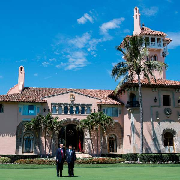 President Donald Trump, left, and Chinese President Xi Jinping pose together at Trump's Mar-a-Lago estate in West Palm Beach, Florida, on April 7, 2017. (Credit: Jim Watson / AFP / Getty Images)