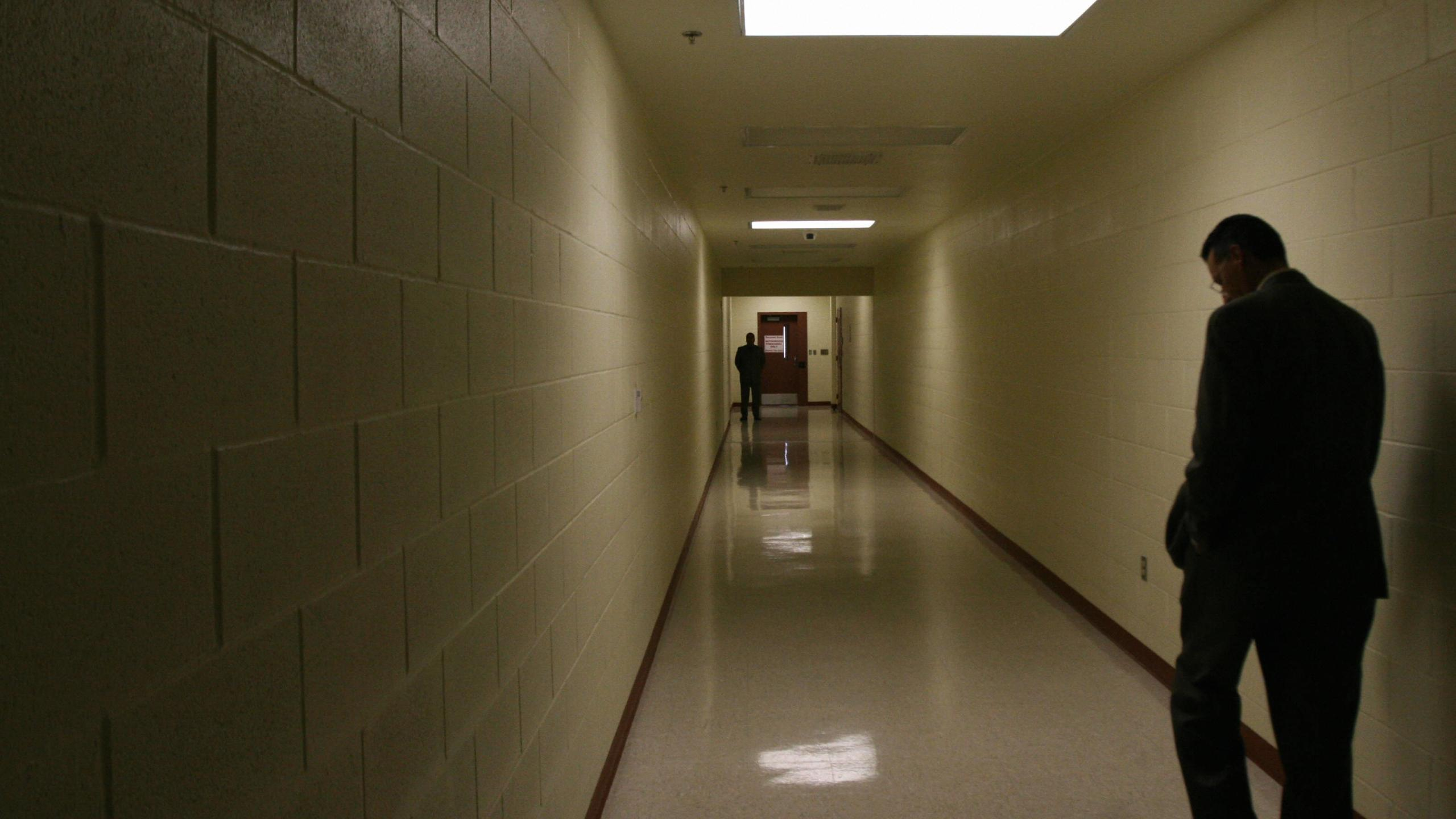 A corridor that leads to a guarded door is seen at the Port Isabel detention facility in Texas on Dec. 17, 2008. (Credit Jose Cabezas / AFP / Getty Images)
