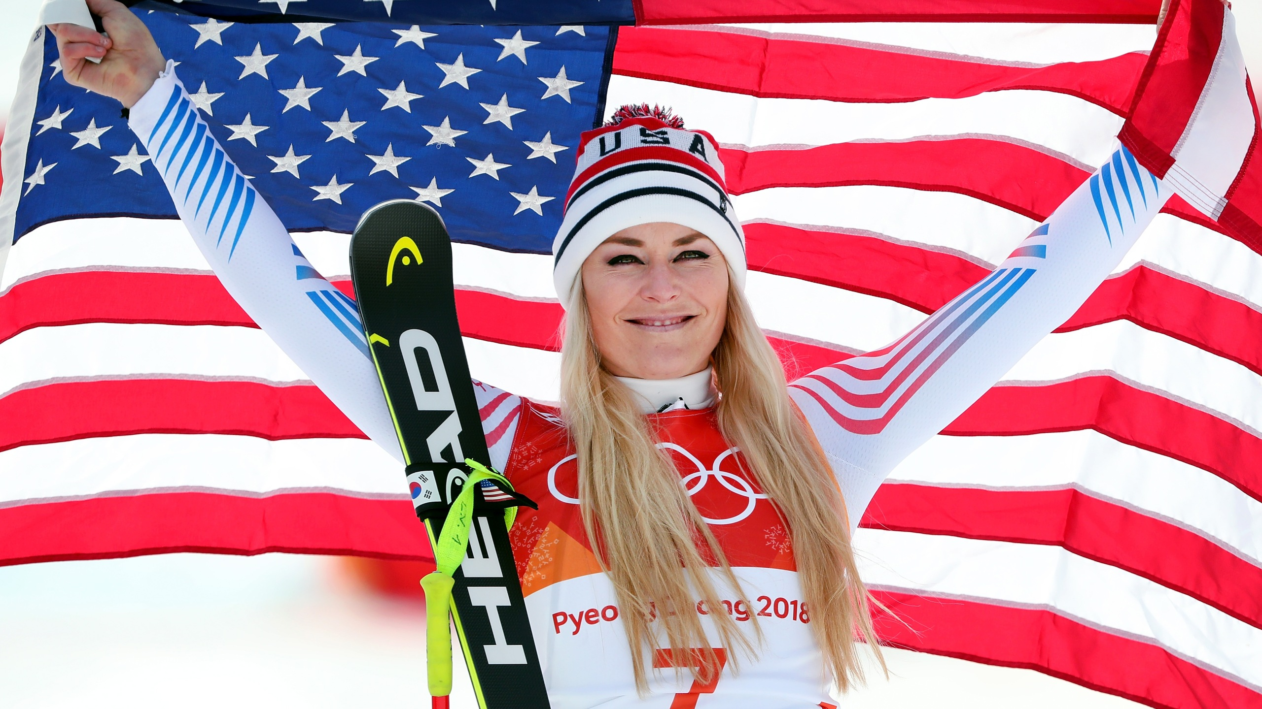 Bronze medallist Lindsey Vonn of the United States celebrates during the victory ceremony for the Ladies' Downhill on day 12 of the PyeongChang 2018 Winter Olympic Games at Jeongseon Alpine Centre on February 21, 2018 in Pyeongchang-gun, South Korea. (Credit: Tom Pennington/Getty Images)