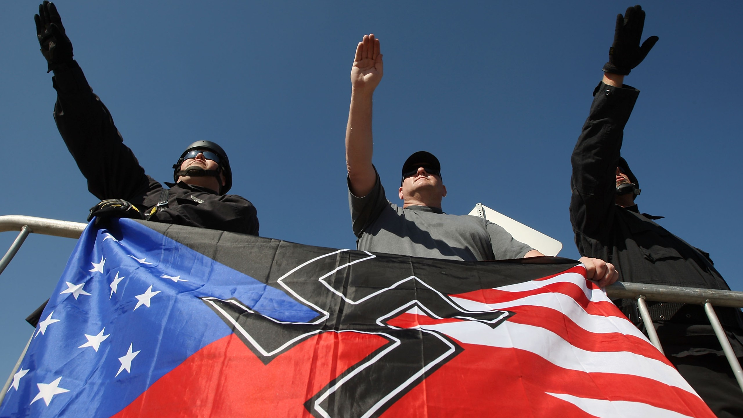 Members of the National Socialist Movement, salute during a rally on Oct. 24, 2009, in Riverside. (Credit: David McNew/Getty Images)