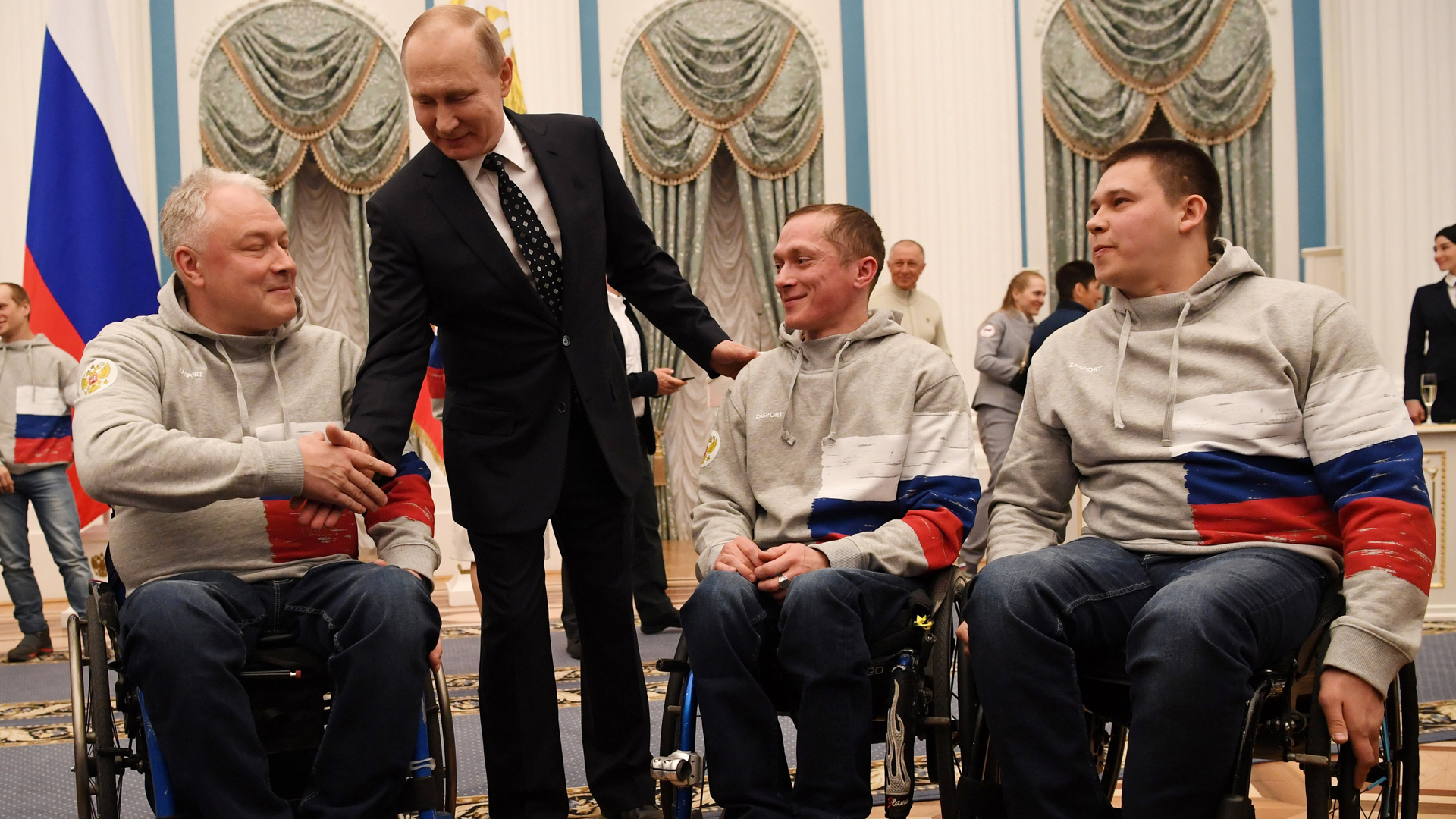 Russian President Vladimir Putin speaks with medalists of the 2018 Pyeongchang Winter Paralympic Games after an award ceremony at the Kremlin in Moscow on March 20, 2018. (Credit: Yuri Kadobnov/AFP/Getty Images)
