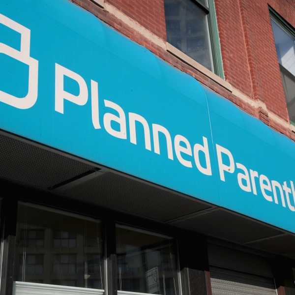 A sign hangs above a Planned Parenthood clinic on May 18, 2018, in Chicago. (Credit: Scott Olson/Getty Images)