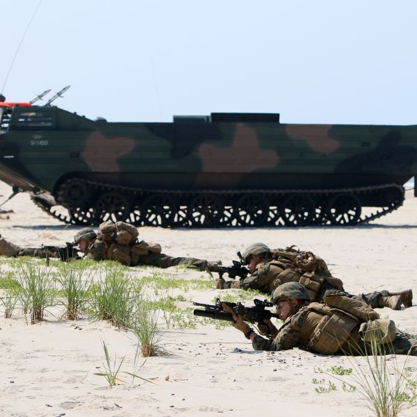 NATO troops take part in a NATO maritime-focused military multinational exercise on June 4, 2018, in Nemirseta on the Baltic sea in Lithuania. (Credit: Petras Malukas/AFP/Getty Images)