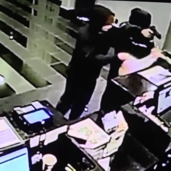 Two robbers are seen on surveillance video during a hold up at The Hills Hotel in Laguna Hills on Feb. 13, 2019.