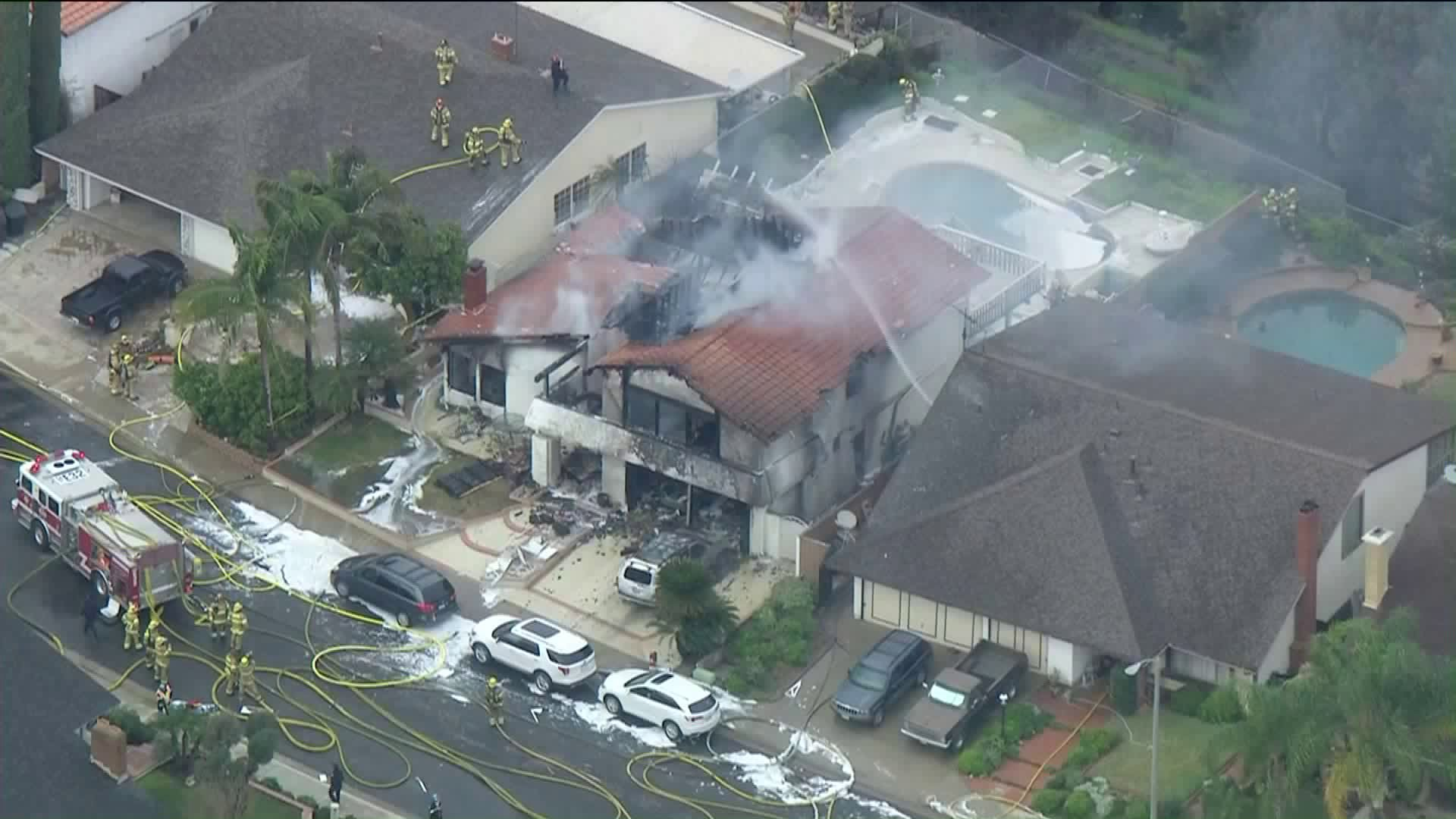 A house destroyed by flames is seen shortly after a small plane crash in Yorba Linda on Feb. 3, 2019. (Credit: KTLA)