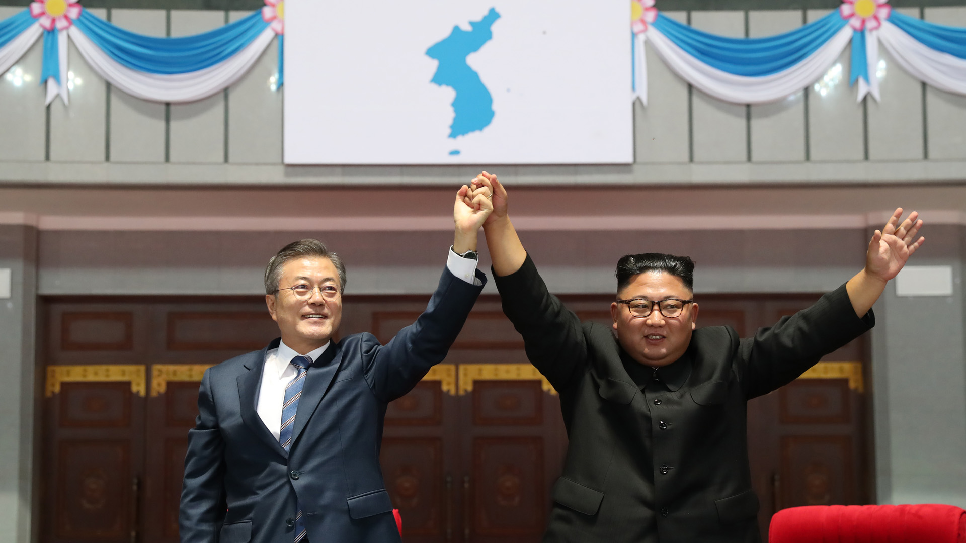 North Korean leader Kim Jong Un (R) and South Korean President Moon Jae-in (L) gesture as they watch the gymnastic and artistic performance at the May Day Stadium on September 19, 2018 in Pyongyang, North Korea. (Credit: Pyeongyang Press Corps/Pool/Getty Images)
