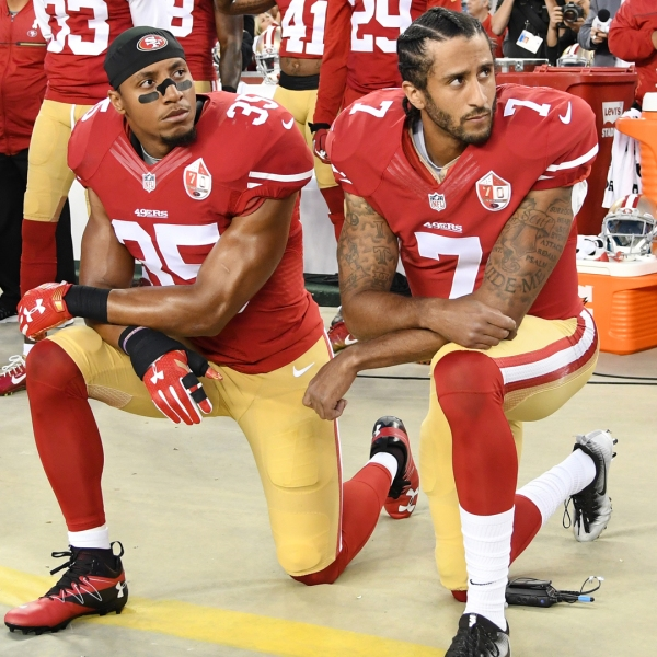 Colin Kaepernick #7 and Eric Reid #35 of the San Francisco 49ers kneel in protest during the national anthem prior to playing the Los Angeles Rams in their NFL game at Levi's Stadium on September 12, 2016 in Santa Clara. (Credit: Thearon W. Henderson/Getty Images)